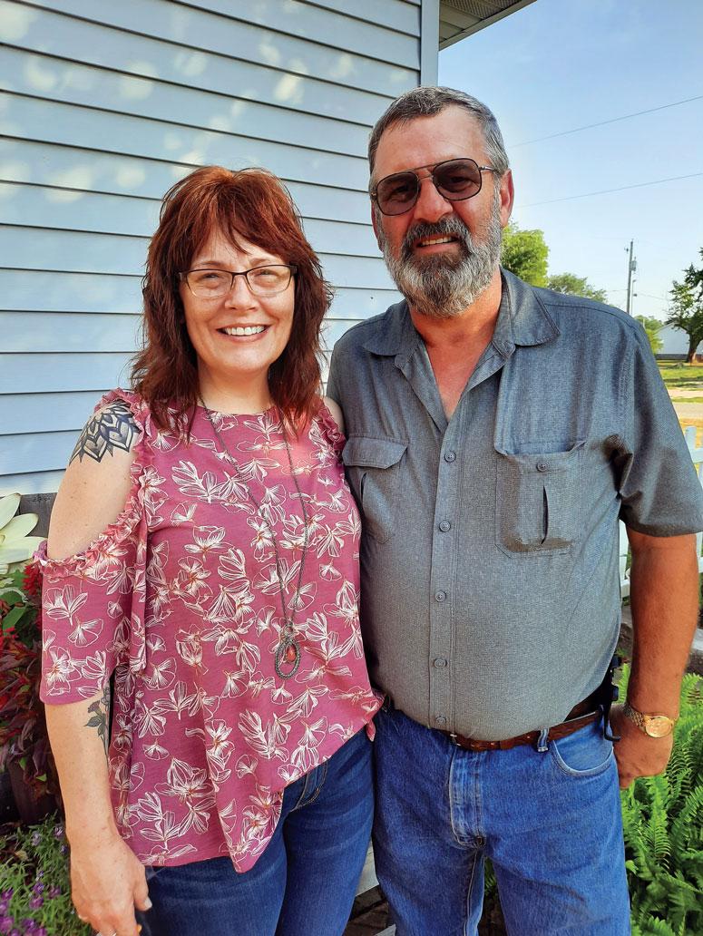 <b>Steve and Molly Jones outside their home in rural Henderson County, Illinois.</b> (Jones family photo)